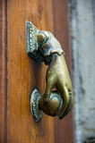 French door knocker. Close up of copper French doorknocker shaped as hand with ball Stock Photo