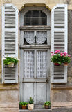 French door with pots of flowers Stock Images