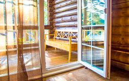 French doors open onto a balcony with a view of leafy green trees. nature. relax concept. vocations. French doors open onto a balcony with a view of leafy green stock images