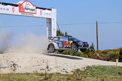 French driver Sebastien Ogier and co-driver Julien Ingrassia. Steer their Volkswagen Polo R WRC during the 2nd stage of the Portugal WRC Rally in Viana do Royalty Free Stock Photography
