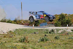 French driver Sebastien Ogier and co-driver Julien Ingrassia. Steer their Volkswagen Polo R WRC during the 2nd stage of the Portugal WRC Rally in Viana do Stock Images