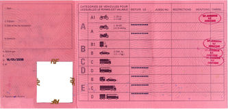 A french / european drivers license, inside description of driving vehicles, red, with passing stamps Stock Photography