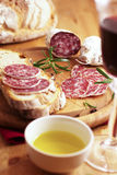 French dry sausage with bread and wine Royalty Free Stock Image