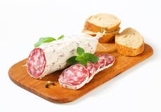 French dry sausage and crispy roll Royalty Free Stock Images