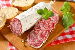 French dry sausage and crispy roll Stock Images