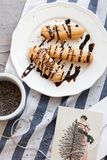 French eclairs on white plate with chocolate Stock Photos