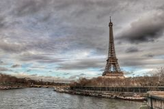 French Eiffel Tower in the cloudy sky stock photography