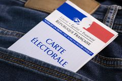 French electoral voter card official government allowing to vote paper in jeans back pocket. France stock photo