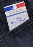 French electoral voter card official government allowing to vote paper in jeans back pocket. France royalty free stock photography