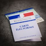 French electoral voter cards official government allowing to vote paper on grey background. France royalty free stock photography