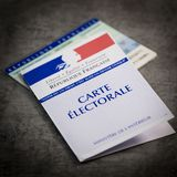 French electoral voter cards official government allowing to vote paper on grey background. France stock photography