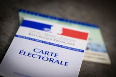 French electoral voter cards official government allowing to vote paper on grey background. France royalty free stock images