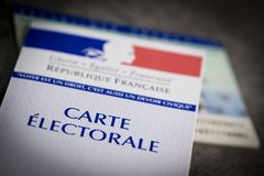 French electoral voter cards official government allowing to vote paper on grey background. France royalty free stock image