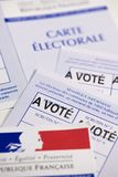 French electoral voter cards official government allowing to vote paper on white background. France royalty free stock photo