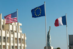 French, European and American Flags under blue sky Royalty Free Stock Photos