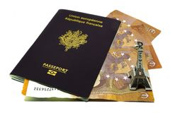 French and european passport close up. French and european passport with three ten euros notes and Eiffel tower toy close up isolated on white background Stock Photography