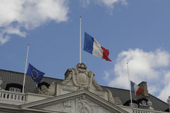 FRENCH AND EUROPEAN UNION FLAGS AT HALF MAST Stock Photography