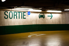 French Exit Sign. Exit sign in French parking garage Stock Image