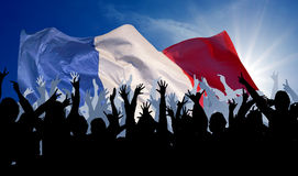 French Fans. An illustration with a silhouetted cheering crowd in front of the French flag Stock Photo