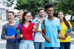 French female student and african american guy with group of mutliethnic students stock photos