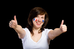 French female supporter with thumbs up gesture Royalty Free Stock Image
