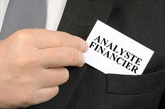 French Financial Analyst Business Card. Business card coming out of the pocket of a jacket in close up stock photography