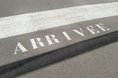 French finishing line. Details of french race finishing line on tarmac with word, arrivee Stock Photos