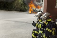 French firefighter binomial attac on car fire say ok. Emergency brigade stock image