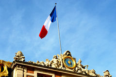 French Flag. The French flag on top of the Palace of Versailles on a bright and sunny day Royalty Free Stock Photos