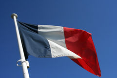 French Flag. A French flag against a blue sky background Stock Images