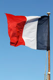 French Flag. The French tricolour flapping in the wind on a flagpole Royalty Free Stock Photos