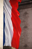 French flag. Huge French flag under the arc de triomphe stock photos
