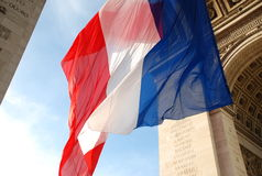 French flag. Huge French flag under the arc de triomphe royalty free stock photography