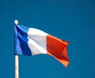 French flag against blue sky Stock Images