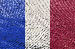 French Flag on a Cobblestone Road Pattern stock photos