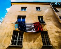 French flag on facade of a building in Paris stock photography