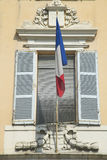 French flag flying from window, Antibes, France Royalty Free Stock Images