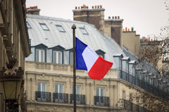 French flag front of ancient building Stock Photos