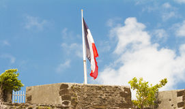 The French flag hoisted on a top of of Fort Saint Louis , Martin. The French flag hoisted on a top of Fort Saint Louis, Martinique island , French West Indies Royalty Free Stock Photos