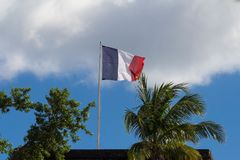 The French flag hoisted on a top of Fort Saint Louis, Martinique island . The French flag hoisted on a top of Fort Saint Louis, Martinique island , French West Royalty Free Stock Photo