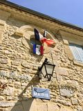 French flag on the municipality house. French flag on the facade of the municipality of a small village Royalty Free Stock Photo