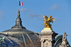 French flag over the Grand Palais, Paris, France.  Royalty Free Stock Photo