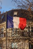 French flag over typical parisian building Royalty Free Stock Image