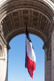 French flag in Paris Triumphal arch. Flag in Paris Triumphal arch, France Stock Photography