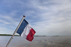 French flag on a river Royalty Free Stock Images