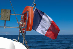 French flag. Sailing boat and french flag royalty free stock photo