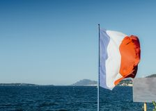 French flag and sea in Cote d`Azur, France royalty free stock photo