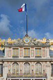 French flag in top of Palace Versailles near Paris Stock Image