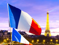 French flag waving in Paris, France stock images