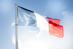 French flag in wind and cloud sky outdoor. In Paris stock photography